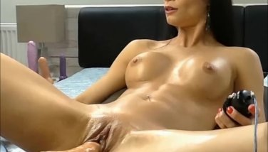Dark haired cutie liking her highly very first time with sexmachine and splashing